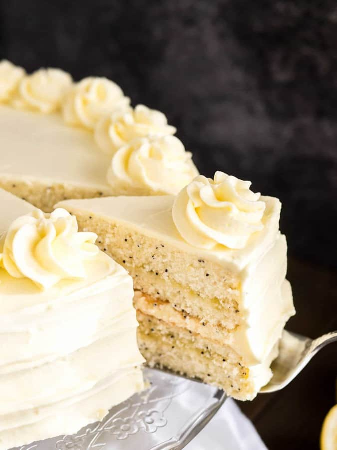 A dreamy Lemon Poppy Seed Cake that's laced with flecks of poppy seeds and topped with a lemon curd frosting. This lemon layer cake is one of my favorite cakes for spring and summer!