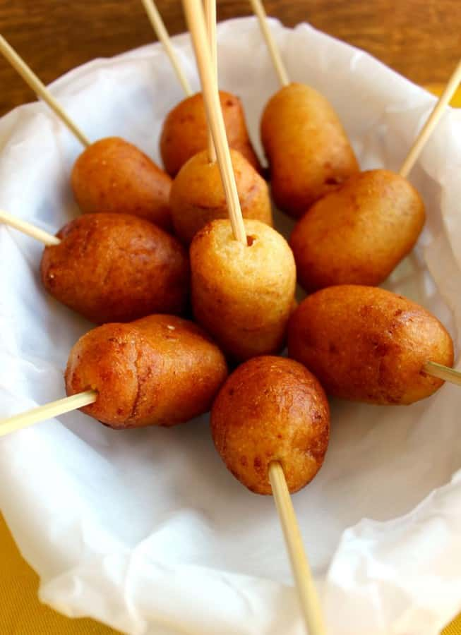 Mini Corn Dogs…on a stick ~ Store purchased hot dogs (because I'm not adventurous to make my own) cut and dipped in a sweetened corn batter with white cheddar and fried to a golden brown.