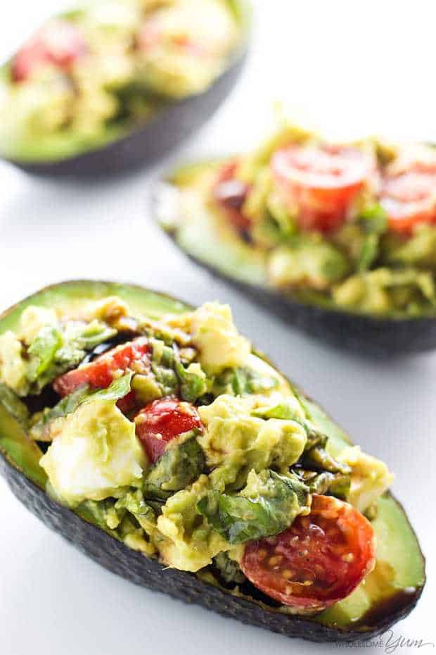 This easy Caprese stuffed avocado recipe is healthy & delicious! It's so simple to make with common ingredients you probably have right now.