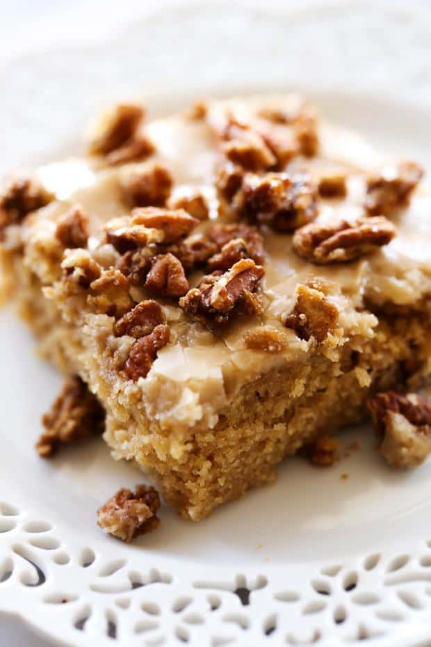 A moist and delicious brown sugar sheet cake with an amazing caramel frosting. The sheet cake is topped wight he most delicious sweet and crunchy pralines for a perfect bite each and every time!