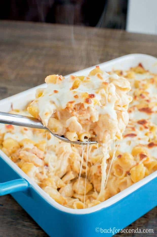 This Buffalo Chicken Alfredo Bake is a quick and easy dinner that everyone will love. A spicy, cheesy casserole, great for busy weeknights, that is pure comfort food!