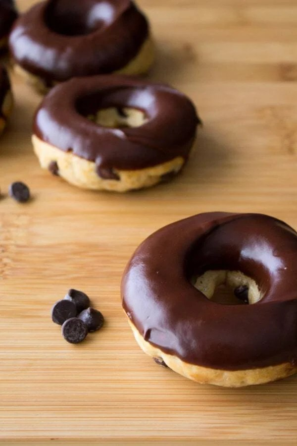 Chocolate Chip Doughnuts with Chocolate Glaze. Because with chocolate chips & baked cake doughnuts – you can't go wrong!
