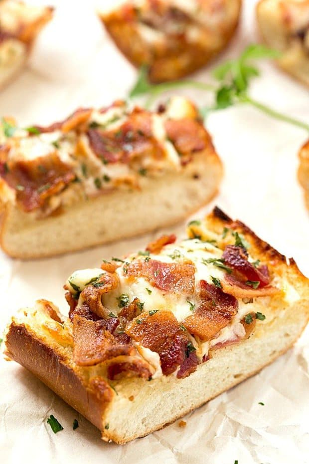 Cheesy Bacon Ranch Garlic Bread – Not just another cheesy garlic bread recipe! This bread is fantastic, and we were able to stop eating it! With a few changes, you can have homemade, and this easy garlic bread is taken to a whole new level! The best garlic spread with the addition of ranch seasoning!