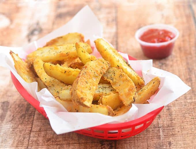 Baked Parmesan Potato Wedges are golden, crisp and loaded with delicious Parmesan and garlic flavors yet baked for a less-guilt snacking!
