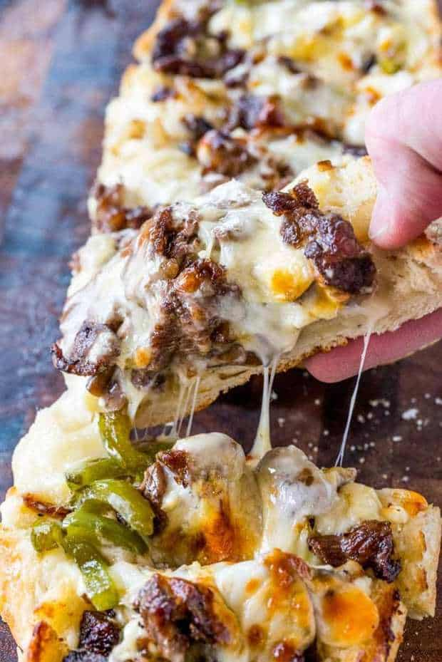 Philly Cheesesteak Cheesy Bread with just a few ingredients is the taste of philly for a crowd!