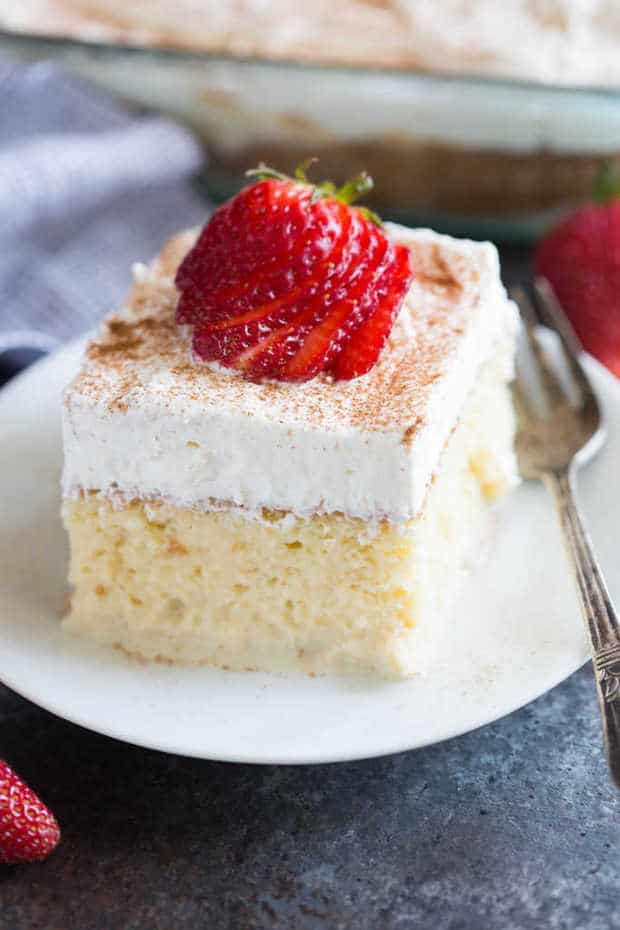 The BEST authentic homemade Tres Leches Cake. An ultra light cake soaked in a sweet milk mixture and topped with fresh whipped cream and cinnamon. This simple Mexican dessert is one of our favorites!
