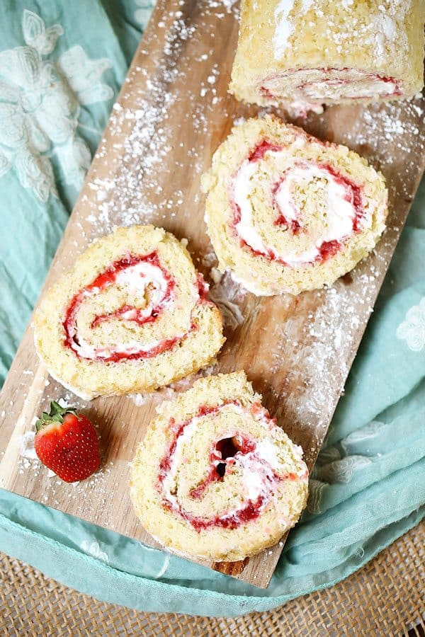 Strawberry Shoetcake Rolls is the perfect summer dessert. It's filled with fresh, in-season strawberries and cream. It's a show stopper for any summer party, barbeque, holiday or birthday.