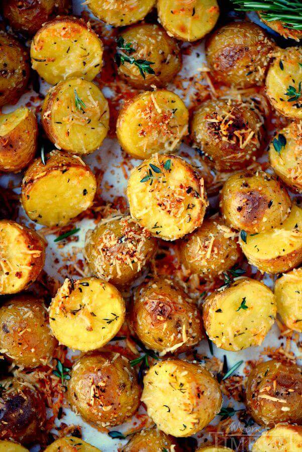 Oven Roasted Herb and Garlic Parmesan Potatoesare the perfect side dish to whatever you're making for dinner tonight! Perfectly crispy on the outside and light and fluffy on the inside!