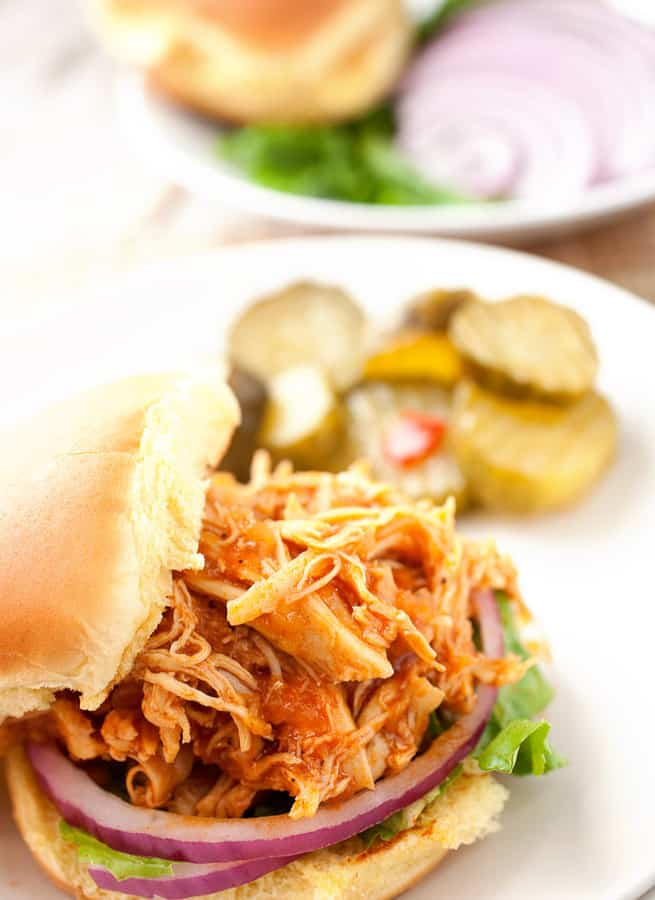 From here dinner is seconds away. Stack some lettuce, and onions on a bun and pile on some chicken sloppy joe mix!