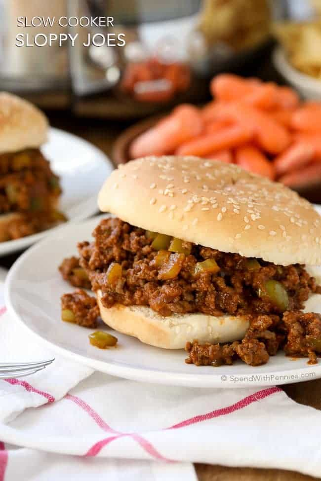 TheseSlow Cooker Sloppy Joes are the perfect way to feed a crowd because they can be prepared up to 24 hours in advance. Ground beef and peppers are cooked in the Crock Pot in a quickzesty sauce for a family favorite meal that's ready when you are!