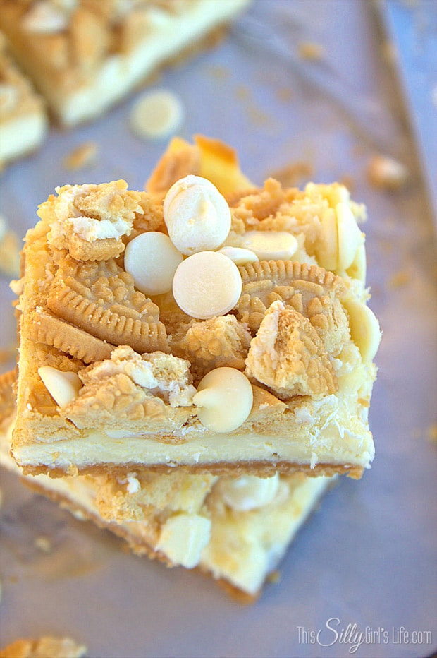 Golden Oreo White Chocolate Cheesecake Bars, golden Oreo crust with a smooth cheesecake filling studded with white chocolate chips!