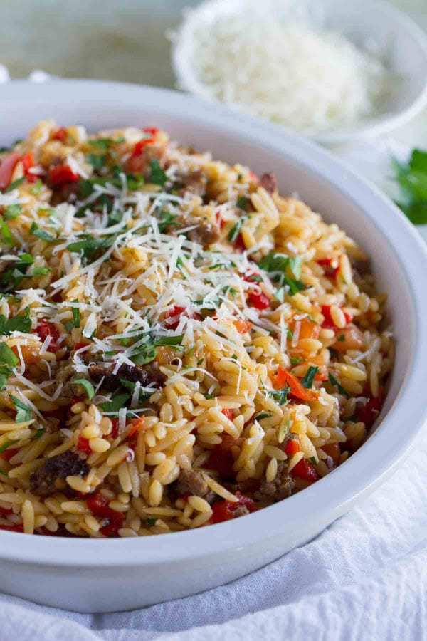 This easy Orzo with Italian Sausage and Peppers is a filling and quick meal – done in under 30 minutes! This is perfect for kids *and* adults!