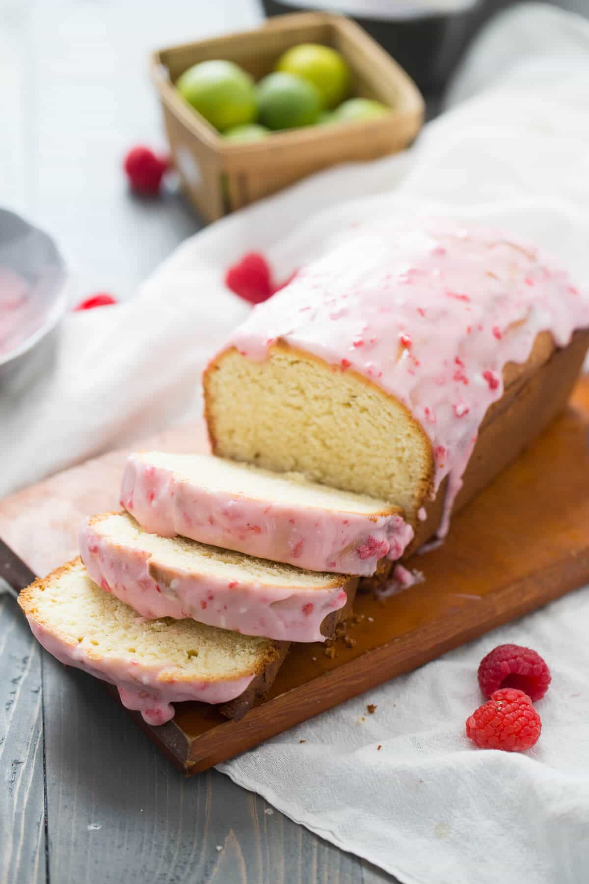 Raspberry Glazed Key Lime Cake is amazing! This pound cake loaf is a tangy key lime cake that is drizzled with a sweet, homemade raspberry glaze. Everything about this easy cake screams happiness!