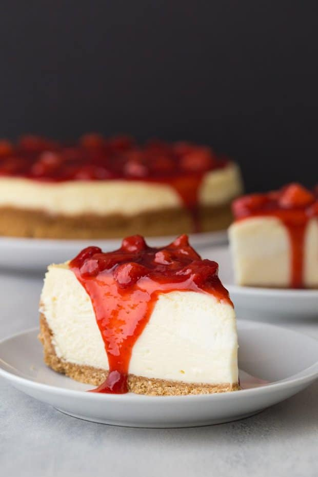 Strawberry Cheesecake features a creamy cheesecake on a graham cracker crust topped with fresh strawberry sauce.