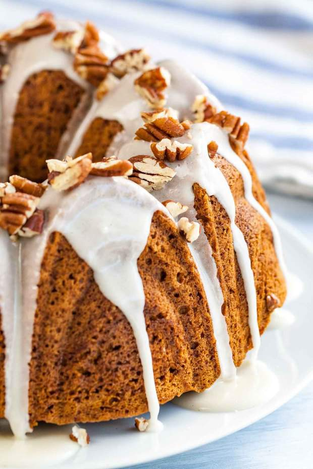 """Pumpkin Bundt Cake is super moist and topped with a maple glaze and toasted pecans! A perfect dessert for the holidays that """"wow's"""" and is easy enough to make even if you aren't totally kitchen confident."""