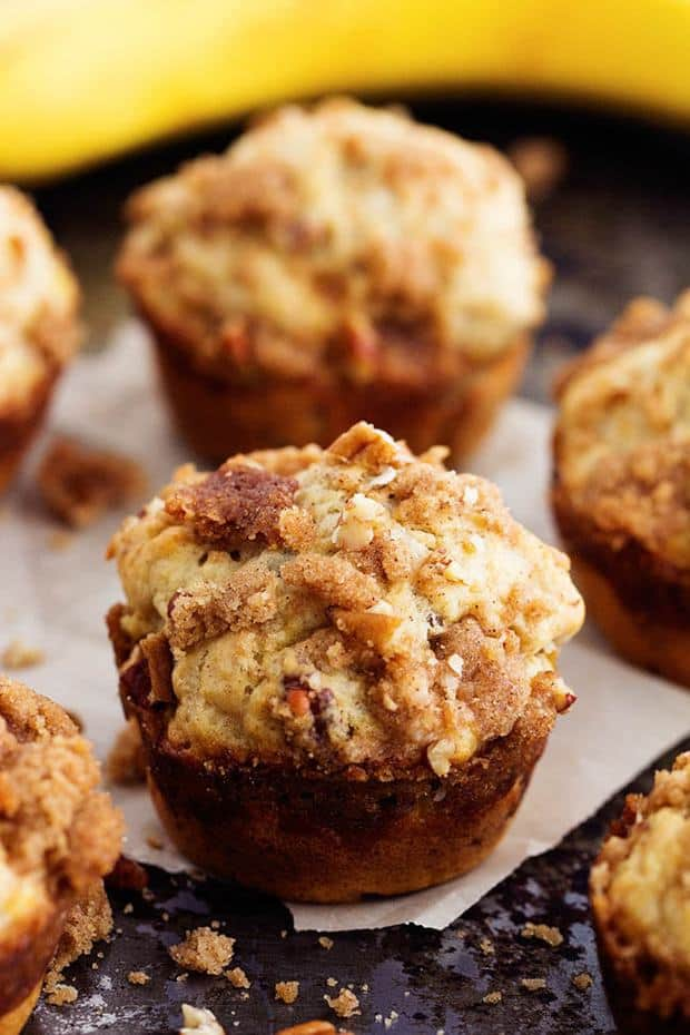 Banana Bread Streusel Muffins -Moist and delicious banana muffins with a crumbly cinnamon streusel topping. This is such a yummy way to use up those over ripe bananas!