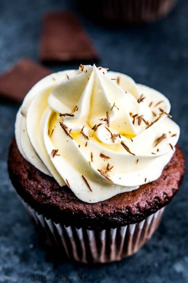 These decadent Triple Chocolate Cupcakes are filled with a creamy chocolate ganache and topped with a luscious white chocolate frosting! It's a rich chocolate dessert recipe everyone will love.
