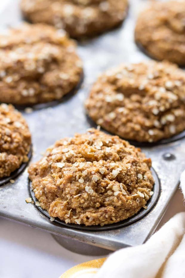 """Muffins are a surprisingly simple thing to make """"skinny"""". I just subbed out all the oil, eggs, dairy and gluten and instead packed them with nutritious ingredients without sacrificing the flavor. Woot! Skinny Spiced Coconut Yogurt Quinoa Muffins are delicious!"""