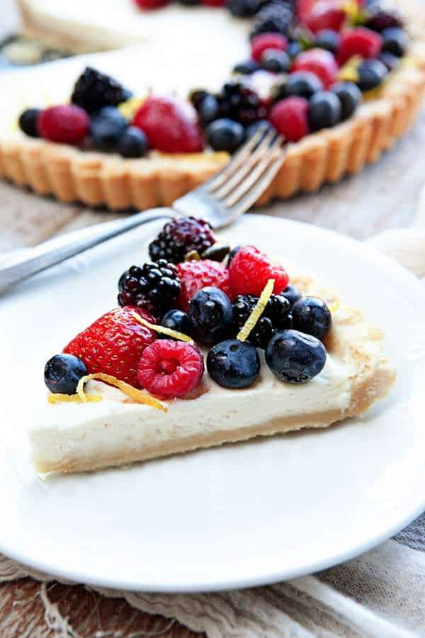 A Lemon Berry Mascarpone Tart is a simple, delicious way to show off all the season's best berries. A creamy mascarpone filling, a hint of fresh lemon, and four kinds of berries, all on top of a sweet shortbread crust!