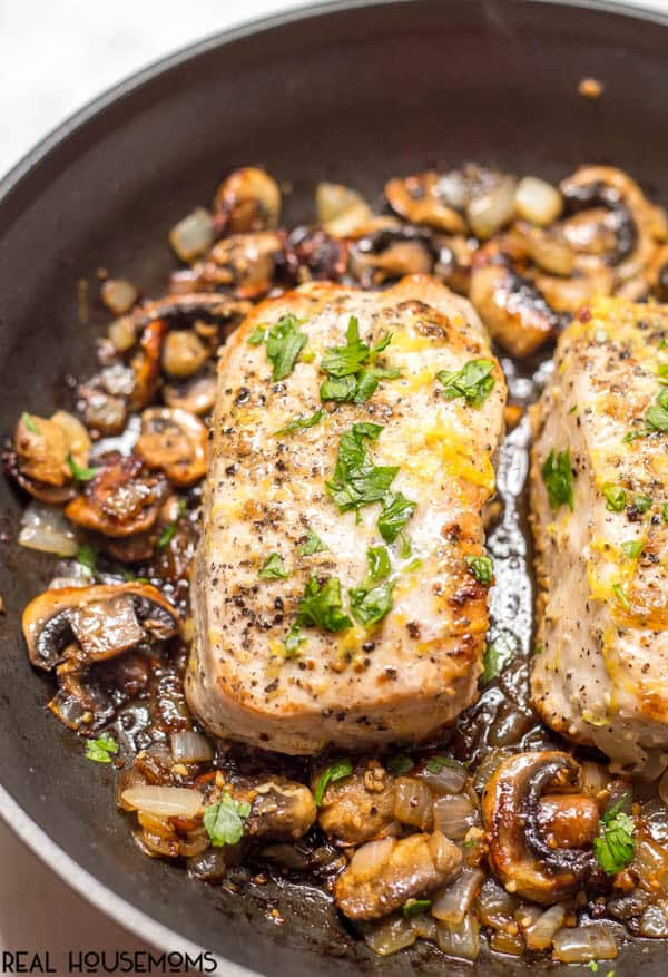 Garlic Butter Pork Chops are an easy one-pan dinner with a delicious mushroom-onion mixture and a hint of lemon to brighten all the flavors! Perfect for a low-carb family dinner!