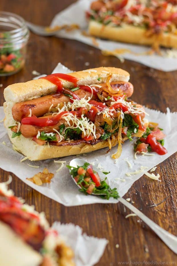 This homemade gourmet hot dog with bacon and salsa, topped with caramelized onions & cheese is a dream come true for your taste buds!