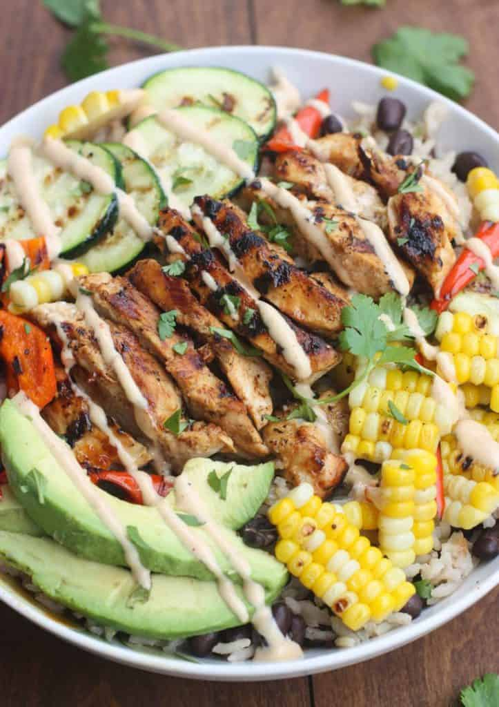 BBQ Ranch Grilled Chicken and Veggie Bowls served over black bean rice with delicious grilled veggies, marinated and grilled chicken, and a delicious Hidden Valley® Honey BBQ Ranch® Dressing.