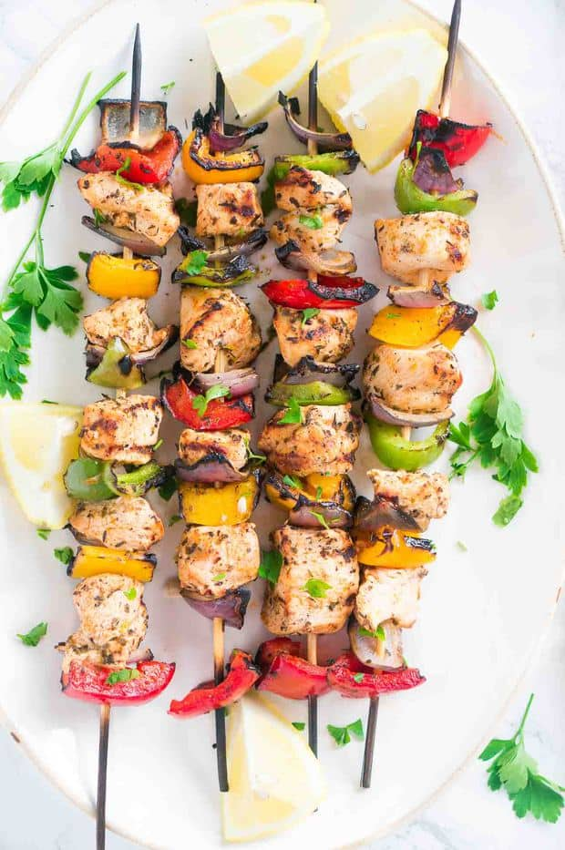 These Grilled Mediterranean Chicken Kebabs are full of flavor, and so easy to make either on the grill or in the oven. Chickenand fresh summer vegetables are marinated in a light Mediterranean-style marinade of lemon juice, olive oil, garlic, and spices, thengrilledonskewersuntil golden brown. Delicious and healthy summer meal.