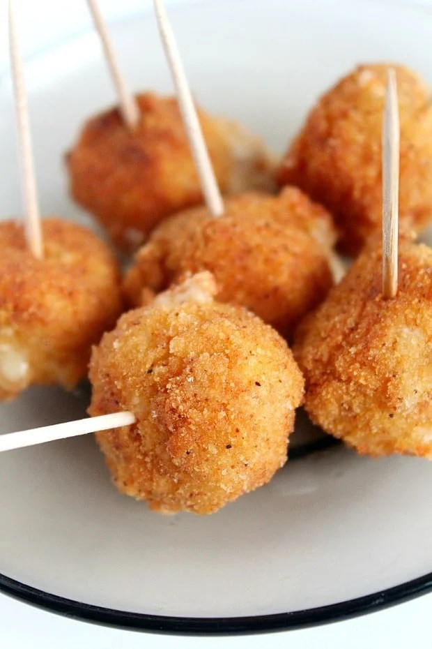 Entertaining soon but don't have much time to spare on making fancy, time consuming appetizers? This spicy fried cheese balls recipe is so insanely easy to make and perfect for any party!