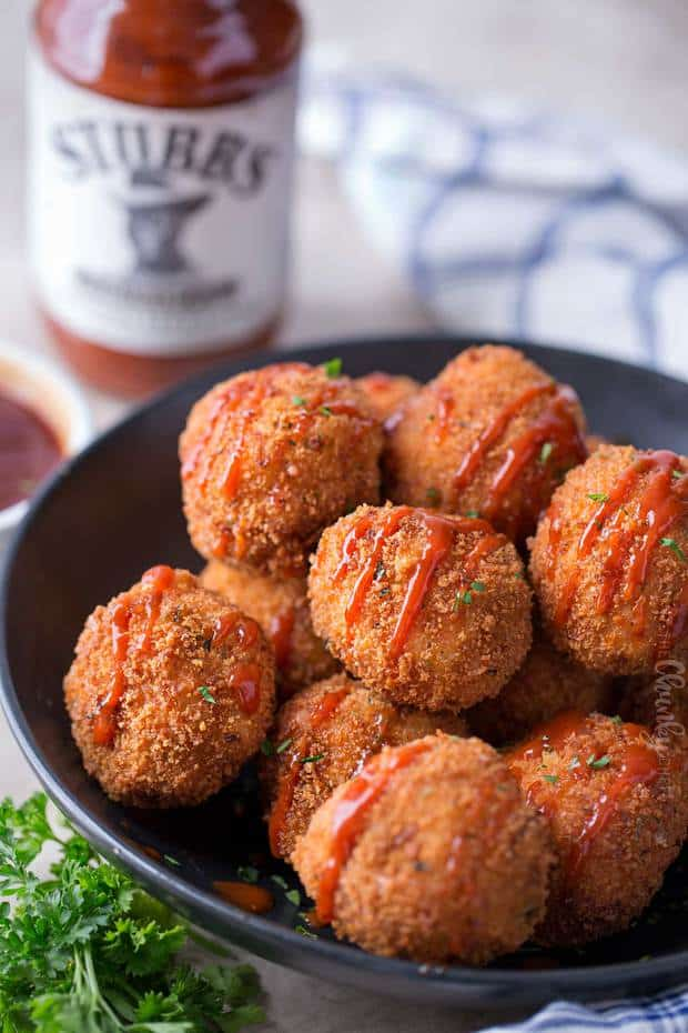 Fried Mac and cheese bites, made with five-cheese Mac and cheese mixed with BBQ pulled pork, for the ultimate game day appetizer!