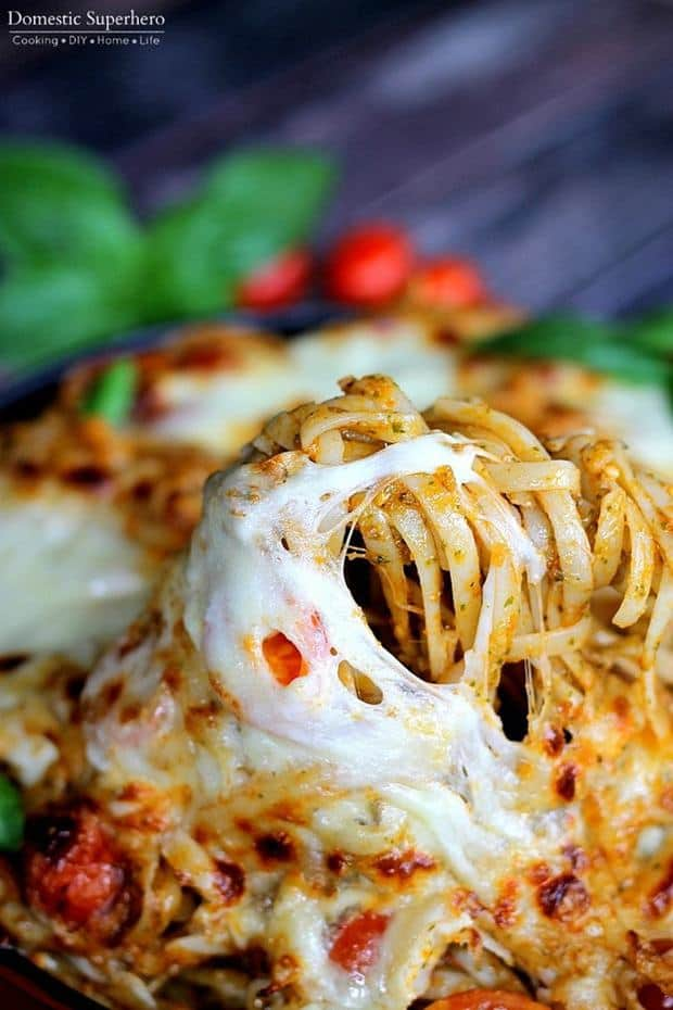 Baked Caprese Pasta is full of fresh basil leaves, tomatoes, fresh mozzarella and more! It's the perfect 20 minute meal!