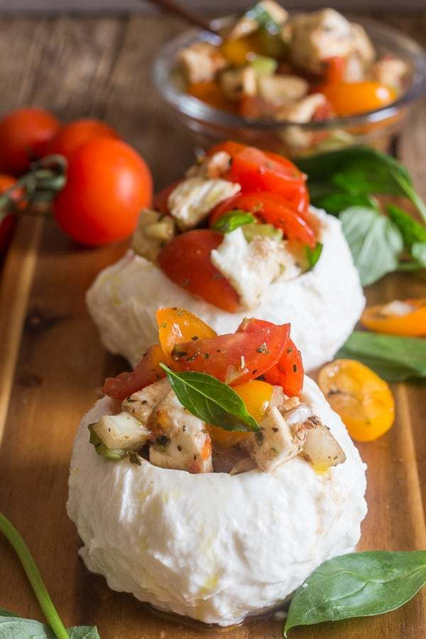 Easy Stuffed Fresh Mozzarella Caprese, the italian dish that screams summer, fresh mozzarella, tomatoes and herbs make this the perfect side dish, appetizer or even main course. You are going to love it.