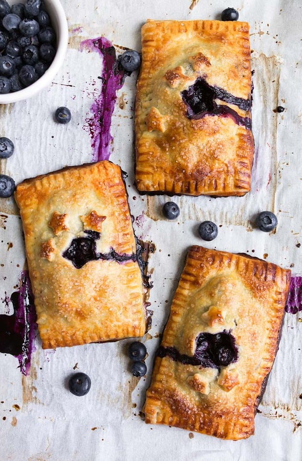 Mini blueberry hand pies with the perfect pie crust that is so easy to work with! Use any fruit you like for these fruit hand pies.