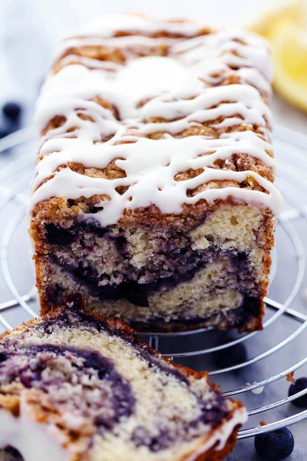 An amazingly moist muffin bread filled with blueberry pie filling. Topped with a crumb topping and drizzled in a lemon glaze this bread is incredible!