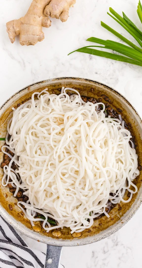Add cooked noodles to the skillet