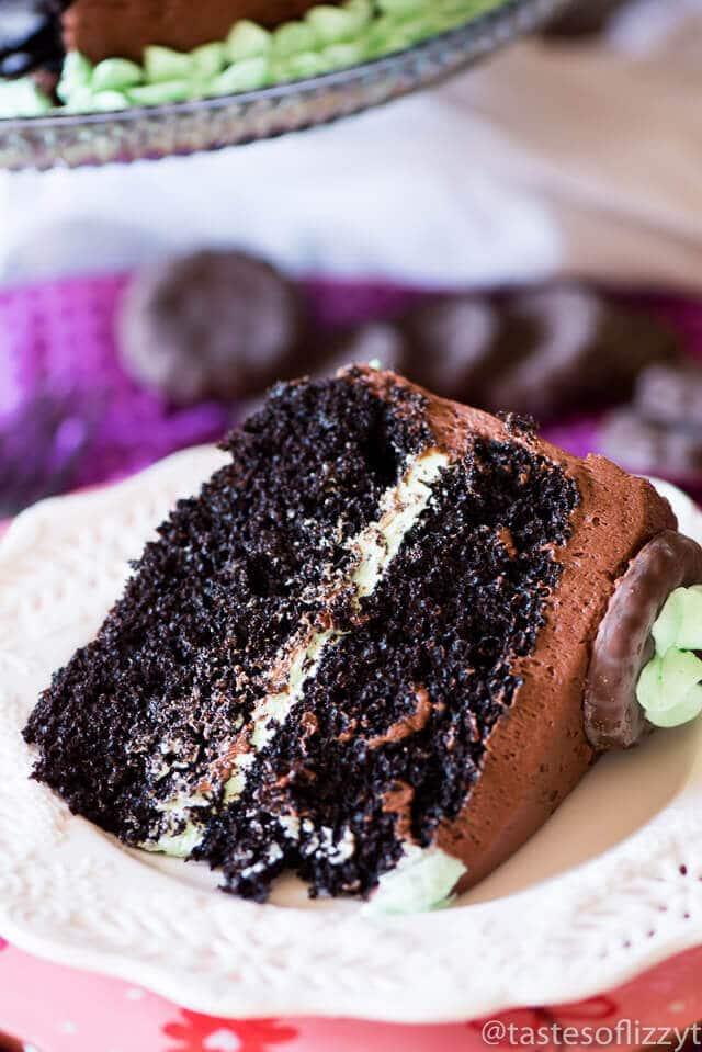 Slice of dark chocolate cake recipe with mint buttercream inside.