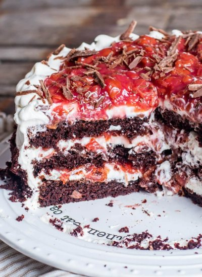 A close up of half of a black forest cake