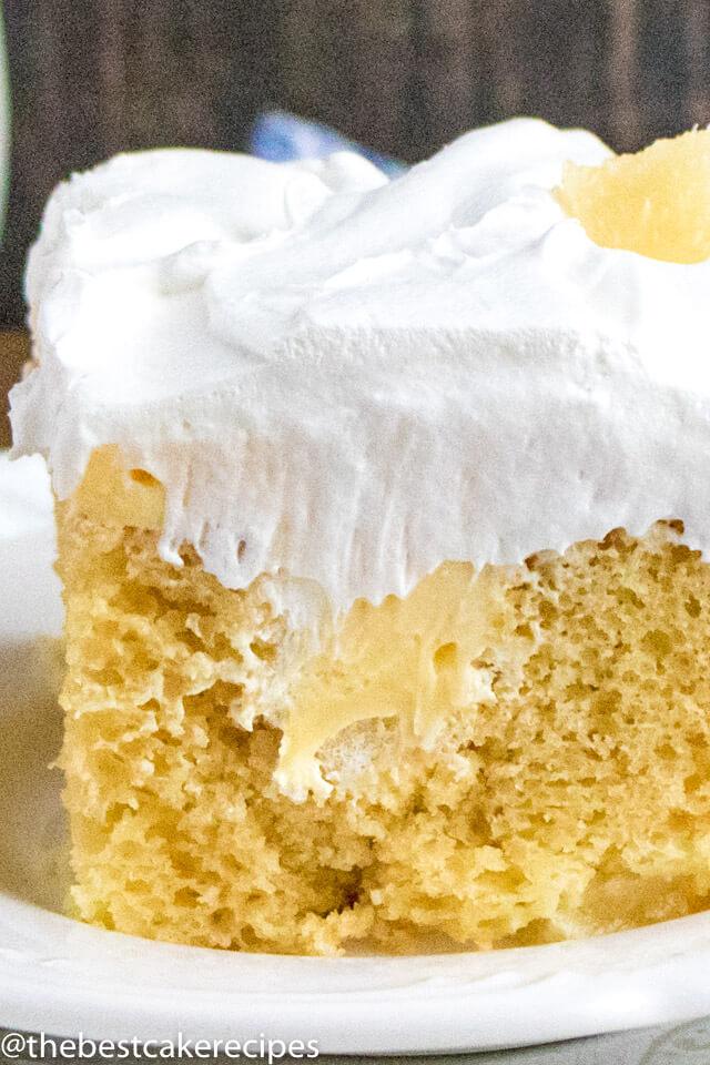 pineapple poke cake on a plate