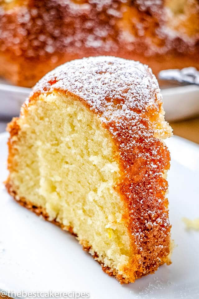 A close up of a slice of cake on a plate, with Sugar