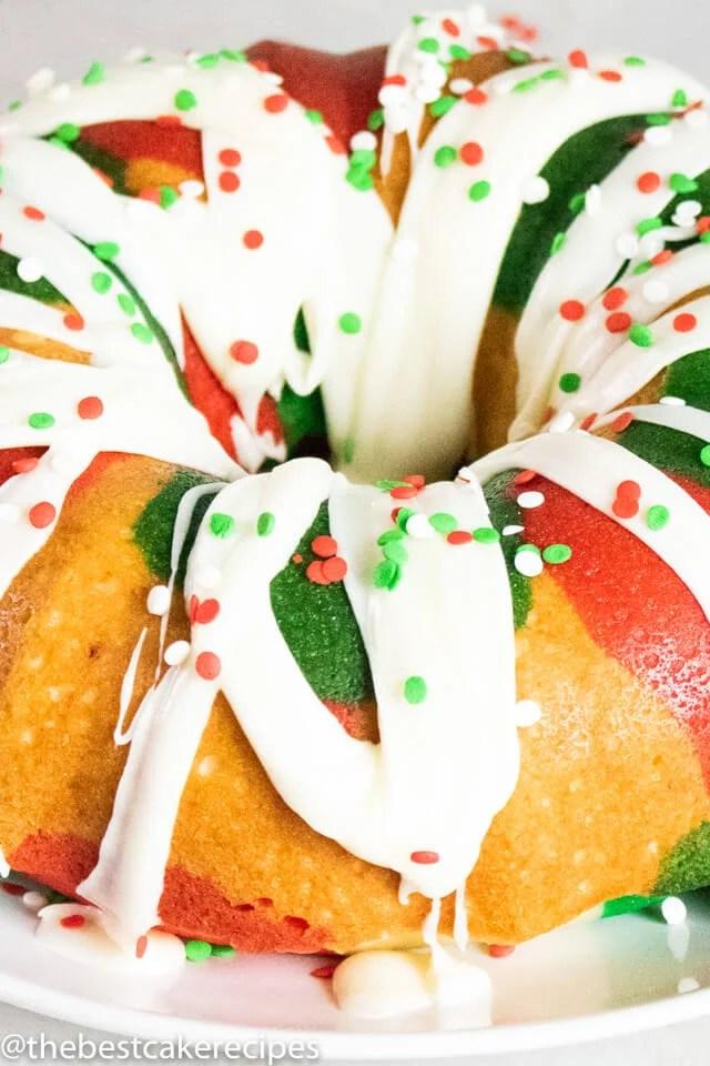 christmas bundt cake with glaze and sprinkles