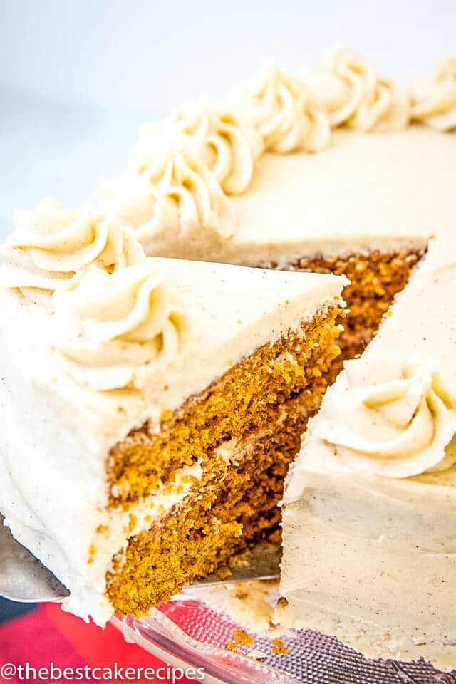 molasses spice layer cake with buttercream frosting with one slice cut
