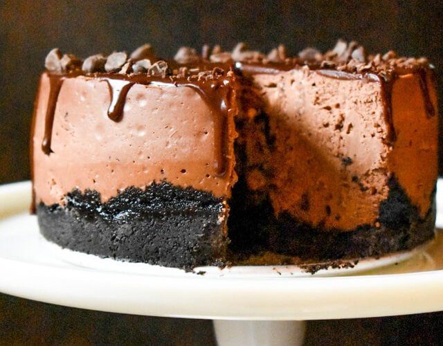 chocolate cheesecake with oreo crust on a cake plate