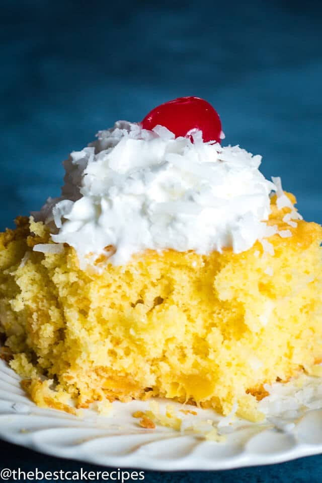4 Ingredient Fruit Cake with whipped cream and cherry