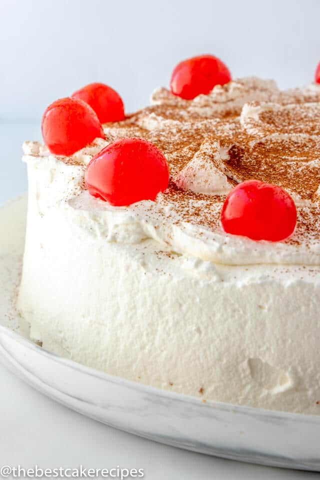 whole uncut Tres Leches Cake with cherries