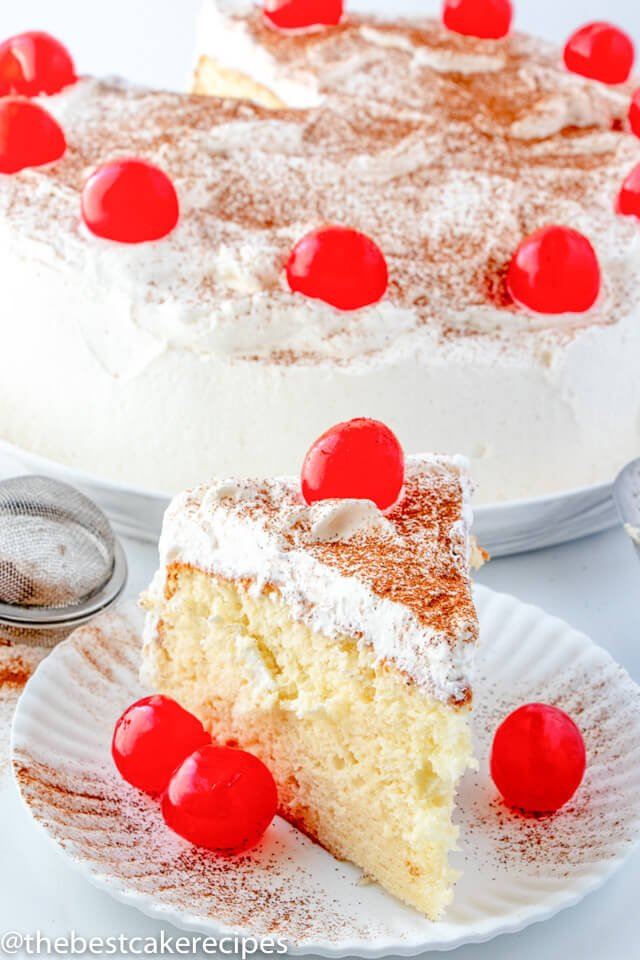 Tres Leches Cake on a plate with cherries