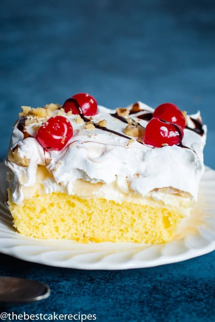 Banana Split Cake Recipe with cherries on a plate