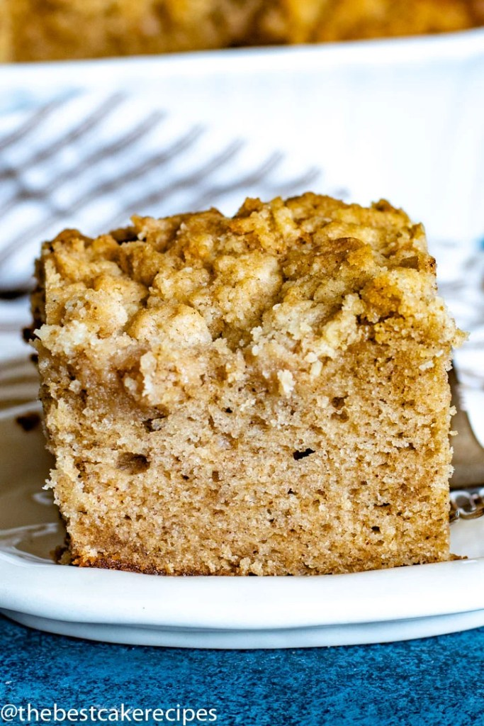 cinnamon crumb cake with topping on a plate