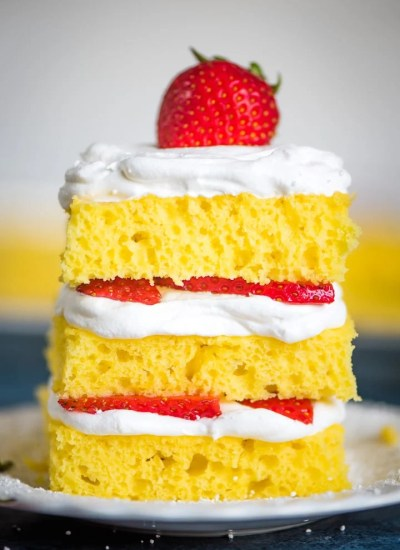 stack of 4 Ingredient Lemon Cake with whipped cream and frosting