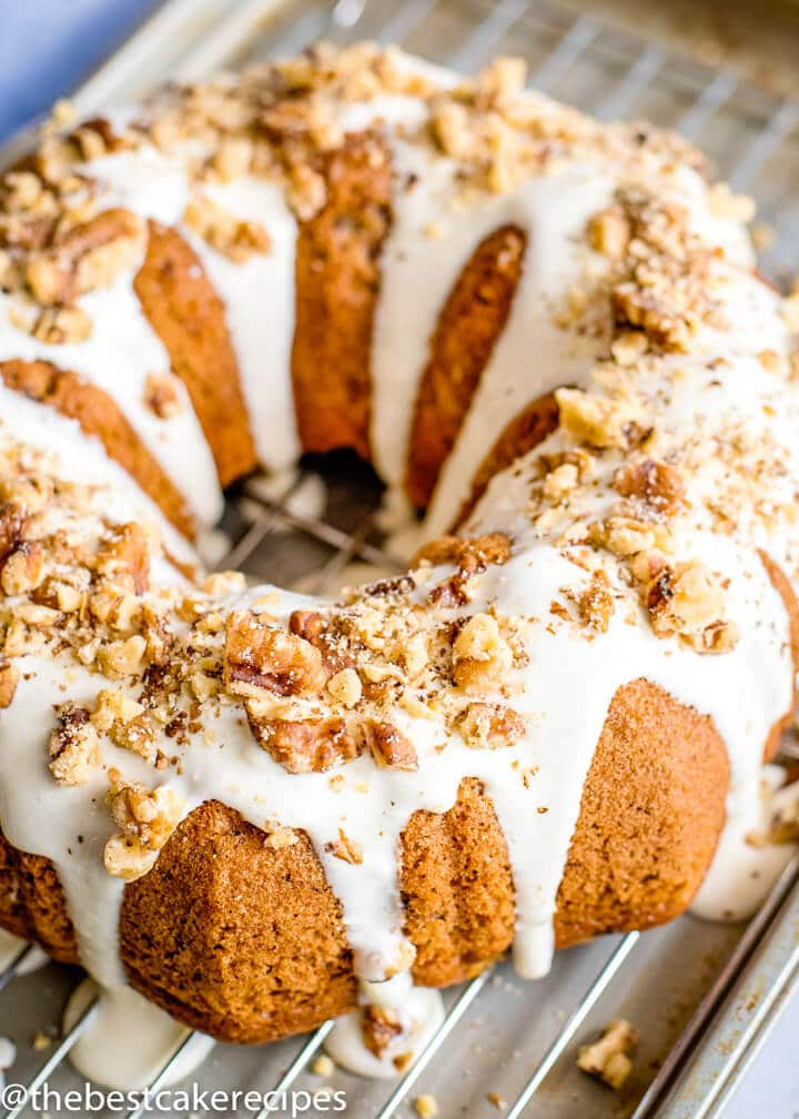 Banana Bundt Cake with walnuts and glaze on a plate