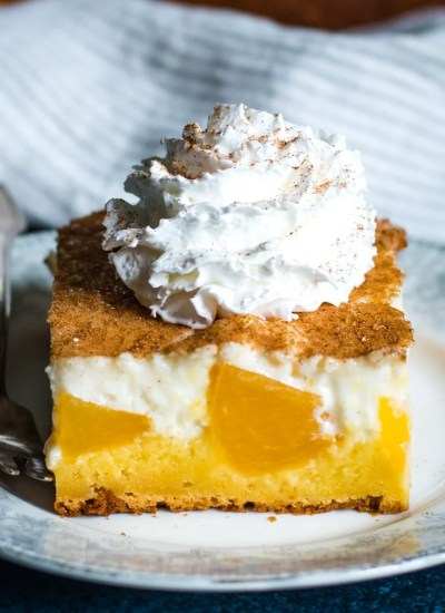Peaches and Cream Cake with whipped cream