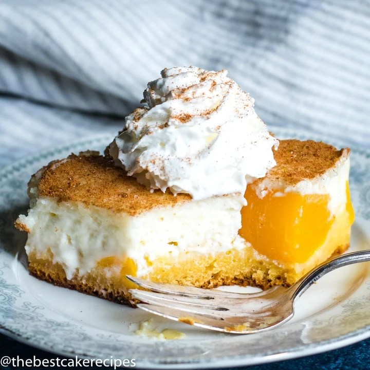 Peaches and Cream Cake on a plate with a bite out